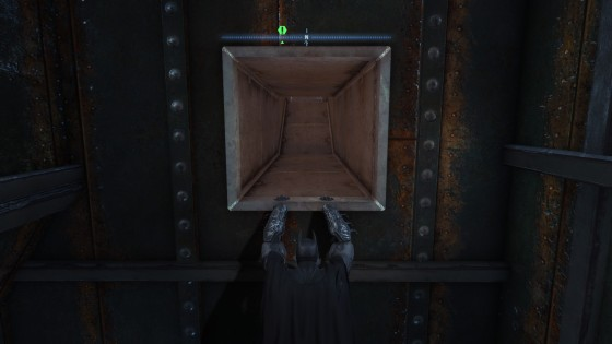 See how Batman's hand don't collide well with the vent? It's one of the bugs, making it impossible for you to climb into the vent...